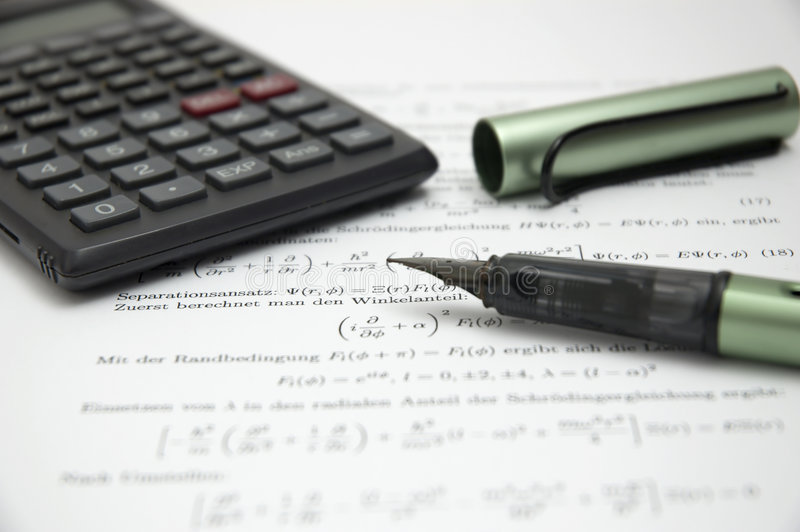 Calculator and pen on scientific paper royalty free stock images