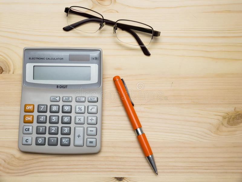 Calculator, pen and spectacles stock images