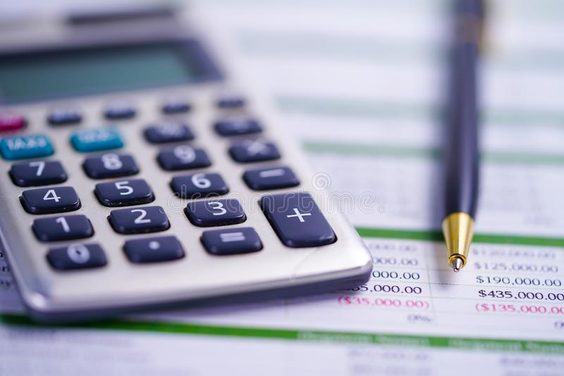Calculator with pen on spreadsheet paper. Finance, Account, Statistics, Analytic research data and Business company meeting. Calculator with pen on spreadsheet stock photo