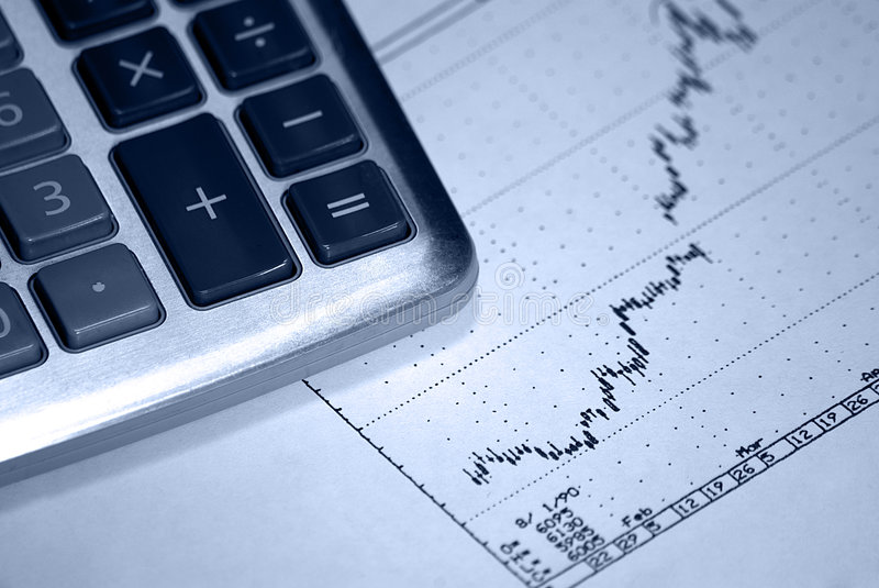 Calculator and positive earning stock chart royalty free stock images