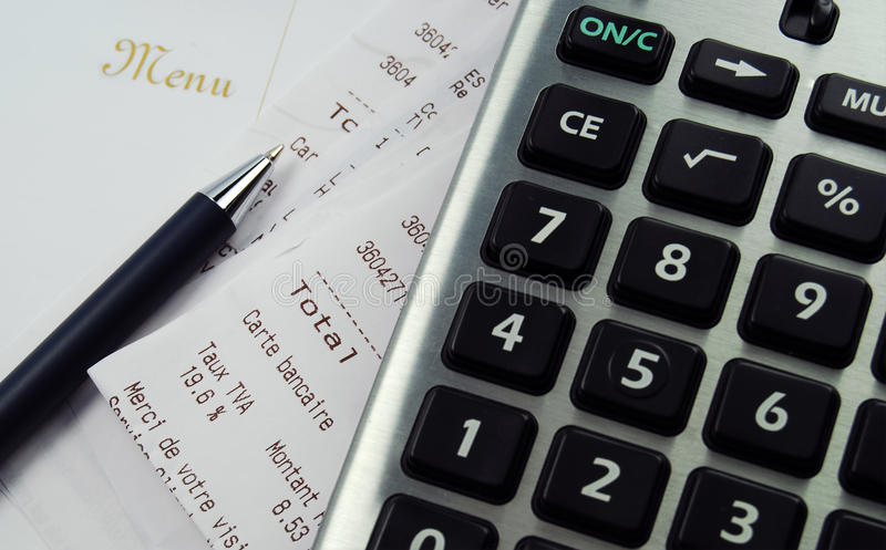 Calculator with receipts and menu stock photography