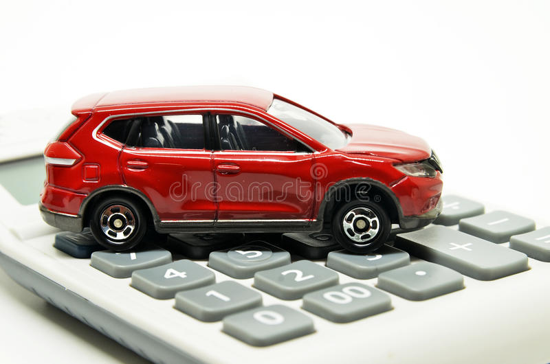 Calculator and red toy car. Isolated on white background stock images