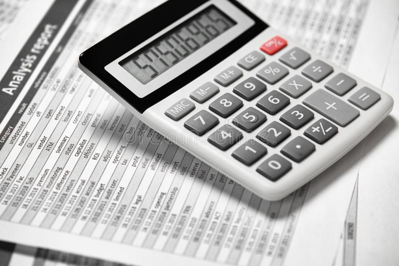 Calculator and reports closeup. Office supplies for working and calculating finance. Business financial accounting concept stock images