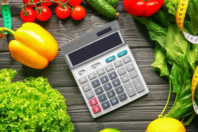 Calculator and set of healthy food royalty free stock photography