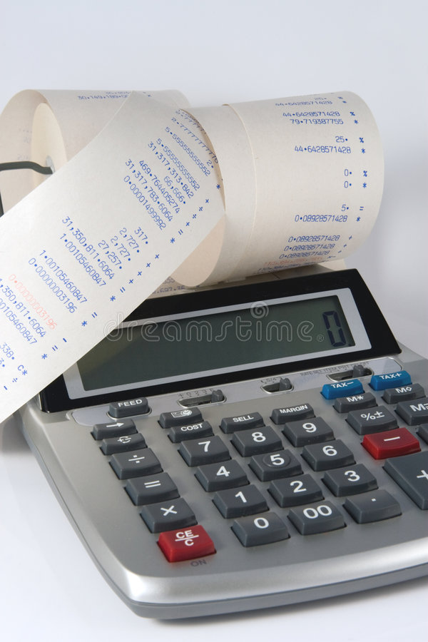 Calculator and Tape. Finance mess of figures on Calculator tape royalty free stock photography