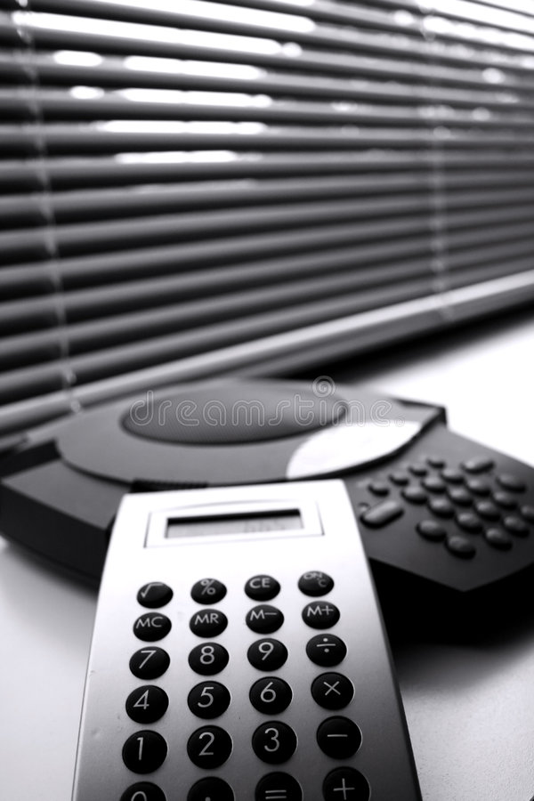 Calculator and telephone royalty free stock image