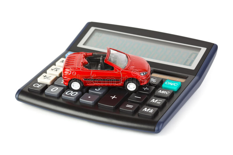 Calculator and toy car. Isolated on white background stock image