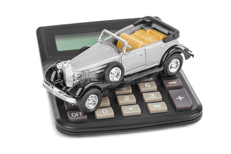 Calculator and toy car. Isolated on white background royalty free stock photography