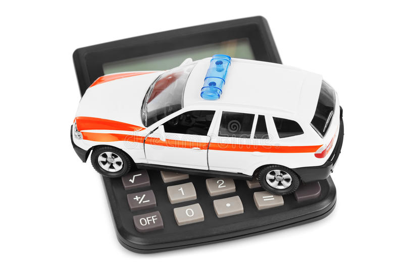 Calculator and toy police car. Isolated on white background stock photography