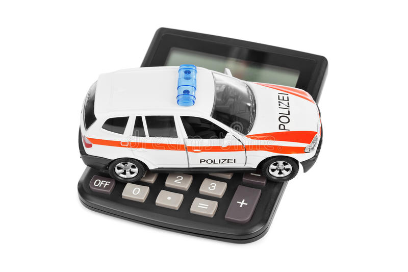 Calculator and toy police car. Isolated on white background royalty free stock photography