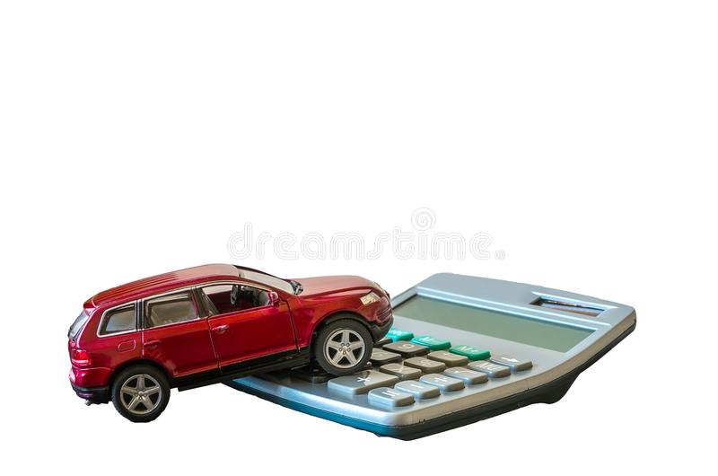Calculator and toy car isolated on white background stock photography