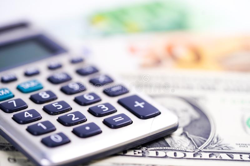 Calculator on US dollar and Euro banknotes. Finance, Account, Statistics, Analytic research data and Business company. Calculator on US dollar and Euro royalty free stock image