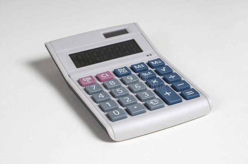 Calculator. In a white background stock image