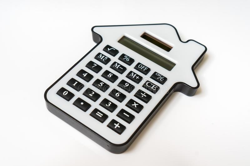 Calculator on white - real estate, lease and mortgage concept. Calculator isolated on white - lease, purchase, investment, mortgage, real estate, sell and buying stock photos