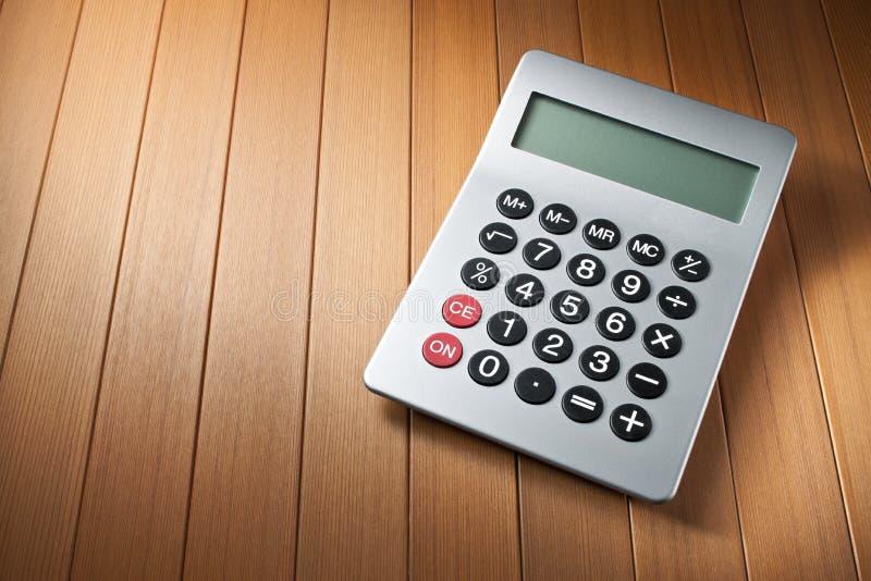 Calculator Wood Background royalty free stock image