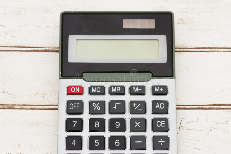 Calculator on wood background royalty free stock photography