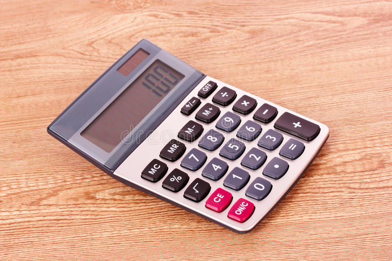Calculator On Wooden Background Stock Photo