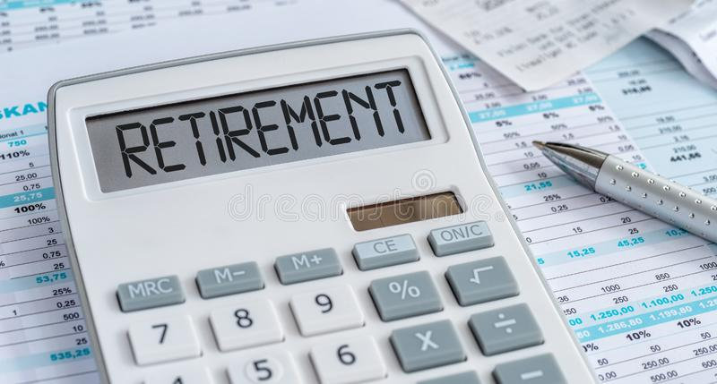 A calculator with the word Retirement on the display stock photos