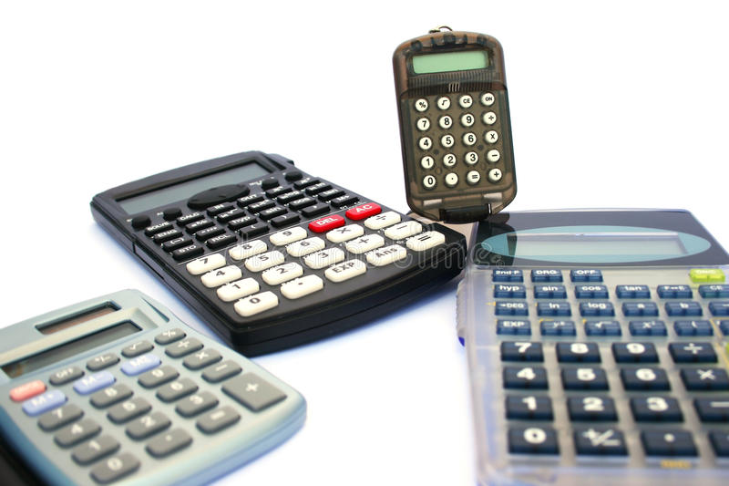 Calculators. Four calculators isolated on white background royalty free stock images