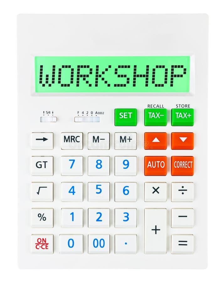 Calculatrice avec l'ATELIER sur l'affichage images stock