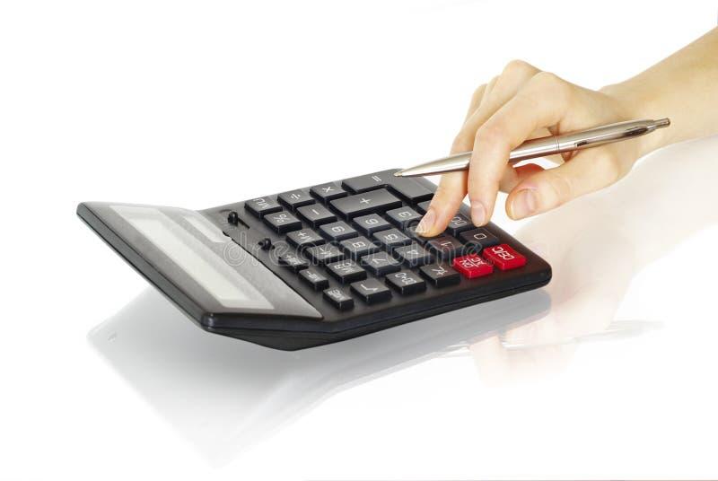 Calculatrice avec la main photo libre de droits
