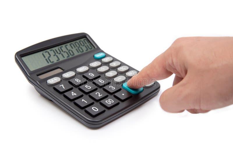 Calculatrice avec la main d'isolement sur le fond blanc photographie stock libre de droits