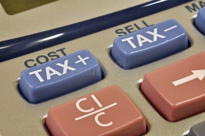 Calculatrice d'impôts photos stock