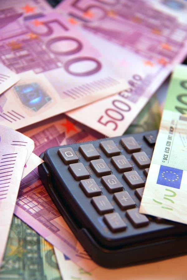 Calculatrice et argent photos libres de droits