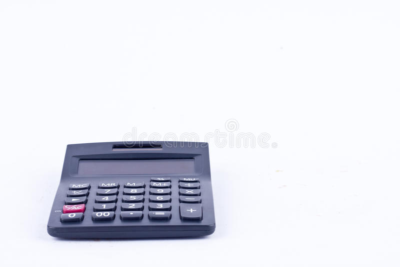 Calculatrice pour calculer l'anticipation commerciale de comptabilité de comptabilité de nombres sur la vue de face de fond blanc photos stock