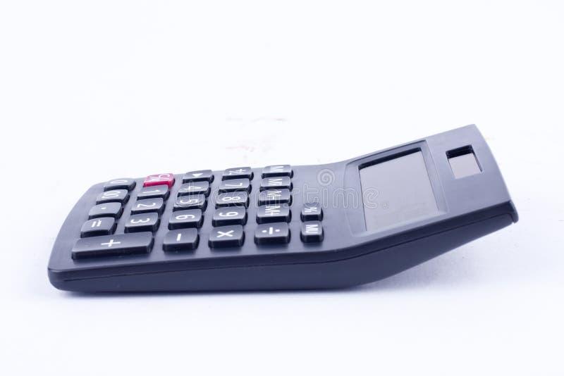 Calculatrice pour calculer l'anticipation commerciale de comptabilité de comptabilité de nombres sur le fond blanc photos stock