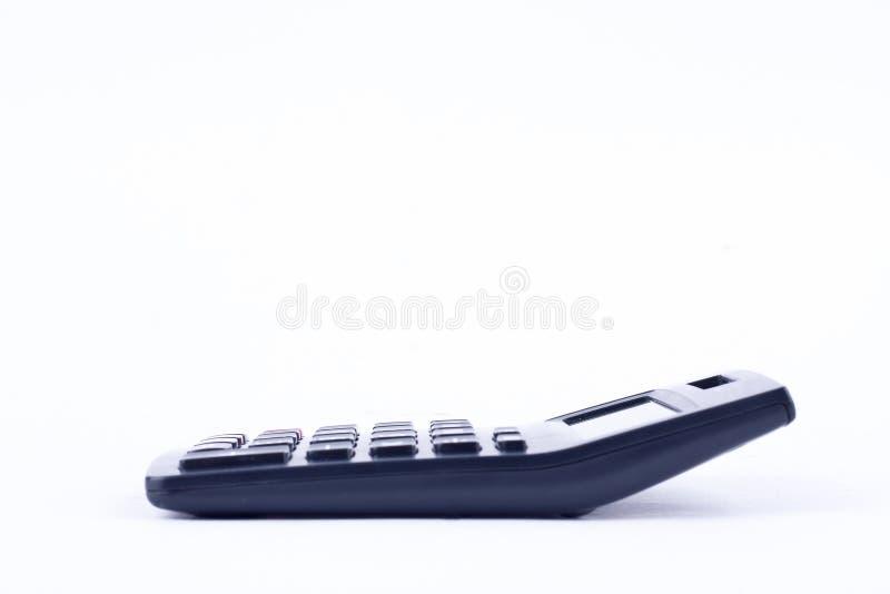 Calculatrice pour calculer l'anticipation commerciale de comptabilité de comptabilité de nombres sur le fond blanc d'isolement image stock