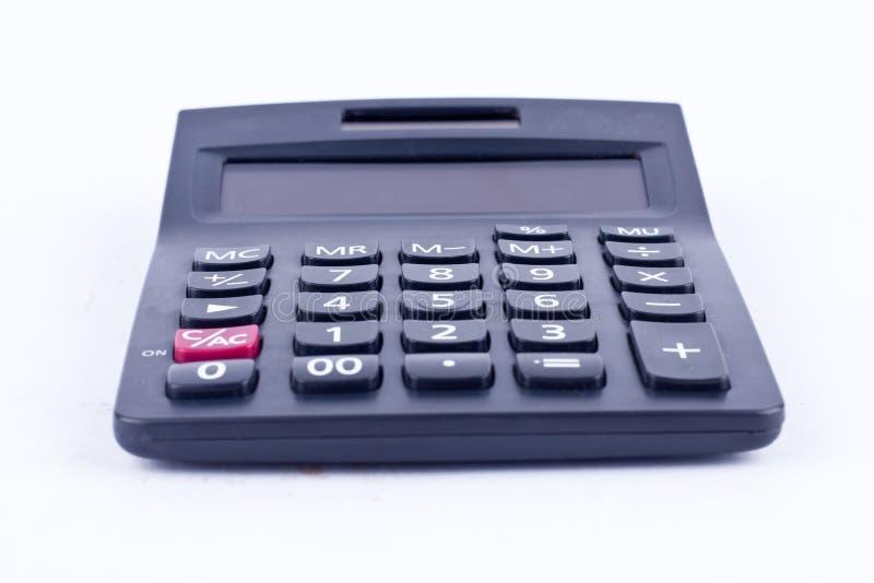 Calculatrice pour calculer l'anticipation commerciale de comptabilité de comptabilité de nombres sur le fond blanc d'isolement photo stock