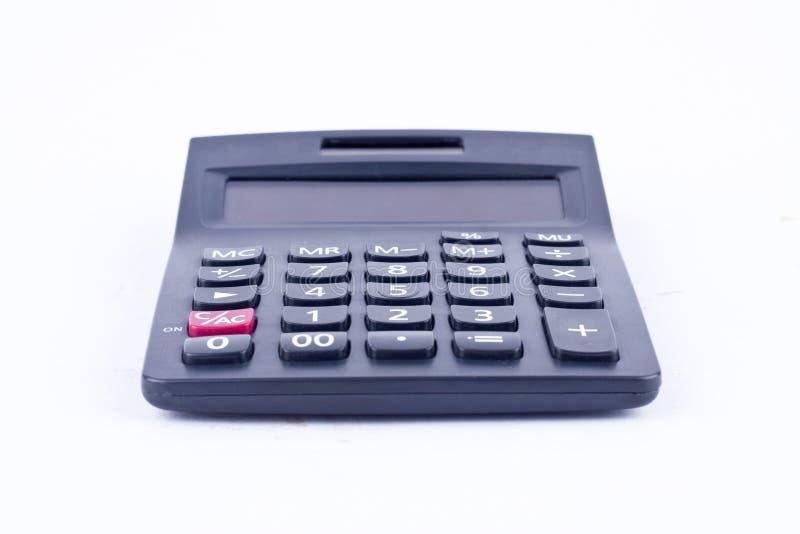 Calculatrice pour calculer l'anticipation commerciale de comptabilité de comptabilité de nombres sur le fond blanc d'isolement photos libres de droits