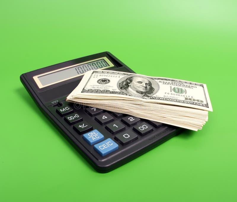 Calcule y dinero fotos de archivo
