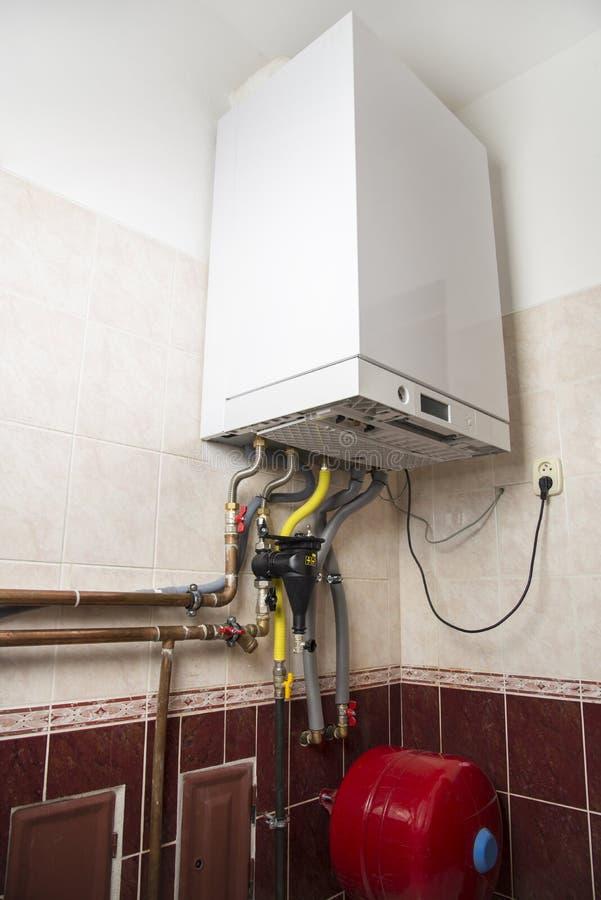 Caldeira nova dos condens do gás para o aquecimento e a água quente imagens de stock royalty free