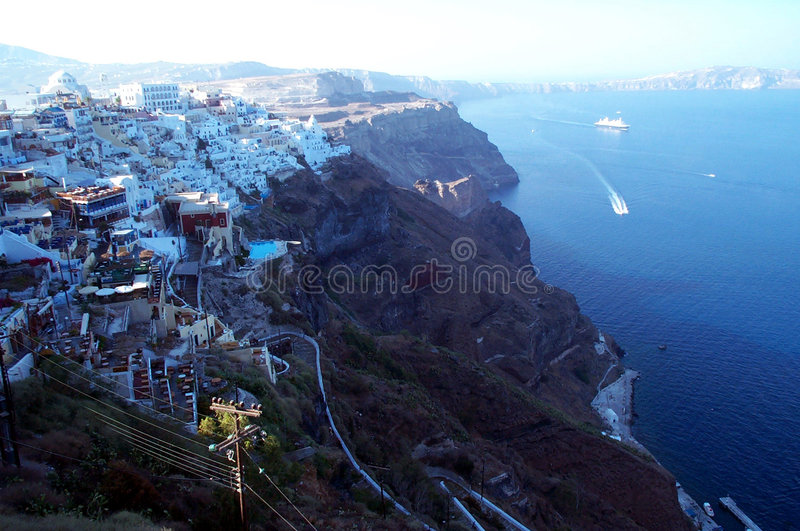 Caldera view - the cliff. Thira, the capital of Santorini island. Dark red volcanic soil against the white of the traditional greek architecture stock photography