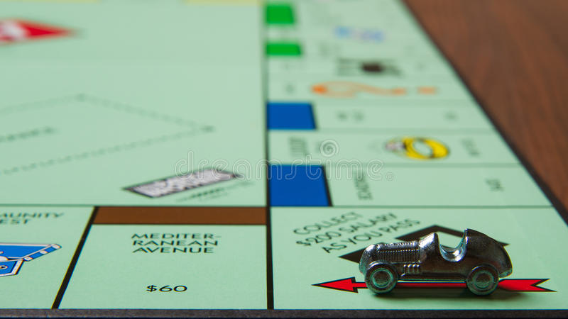 Game Monopoly. CALDWELL, IDAHO/USA - MARCH 16, 2015: Car collected 200 bucks passing go in the game Monopoly royalty free stock photos