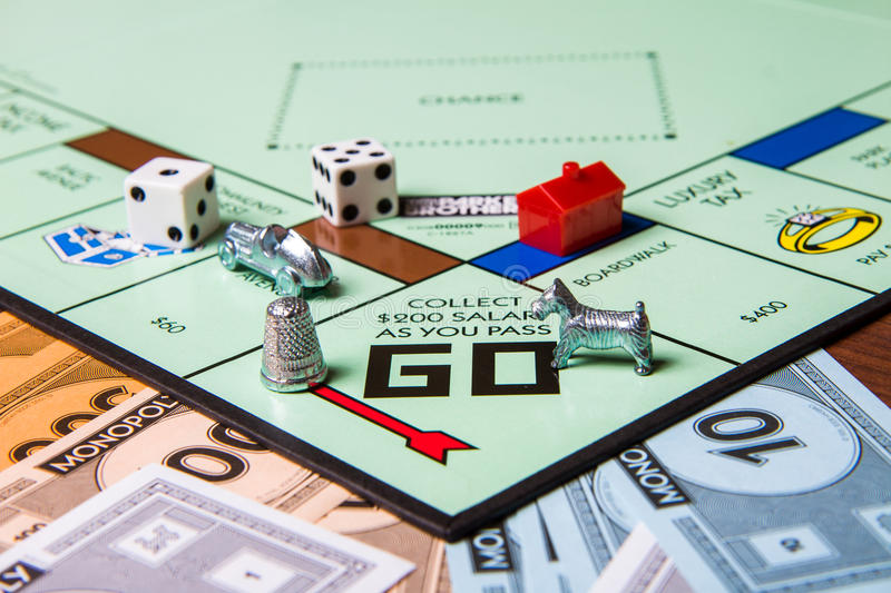 Pieces of a monopoly game royalty free stock photos