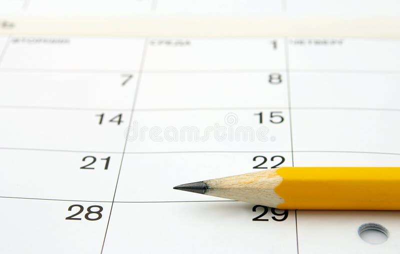 Calendário e um lápis imagens de stock