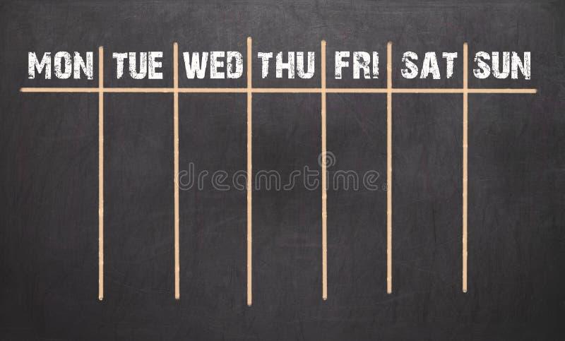 Calendário semanal no fundo do quadro fotos de stock royalty free