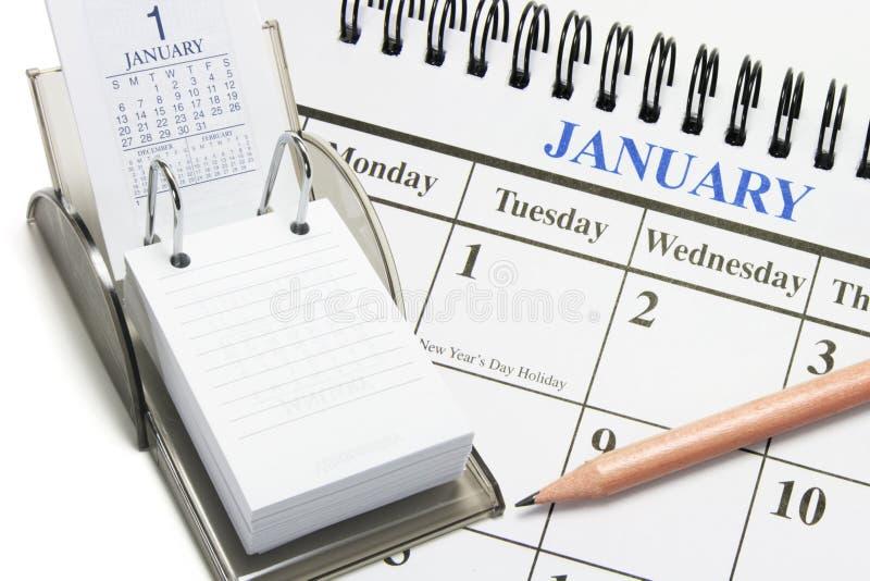 Calendários e lápis imagem de stock royalty free