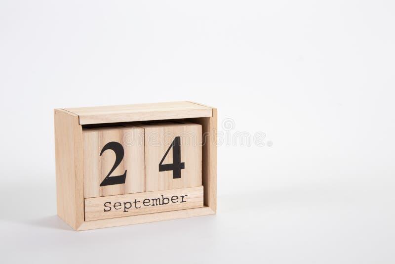 Calend?rio o 24 de setembro de madeira em um fundo branco imagem de stock royalty free