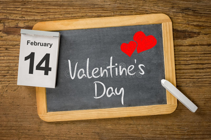 Calendar and blackboard showing February 14 stock photos