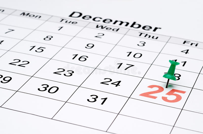 A calendar with Christmas day marked with a stock images