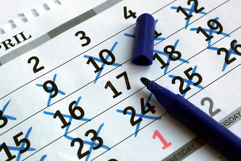 On the table is a calendar sheet with the date marked stock photos