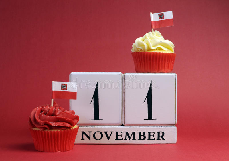 Calendar date for Poland National Independence Day, Novemebr 11, with mini cup cakes and Polish flags in red and white theme colo stock photos