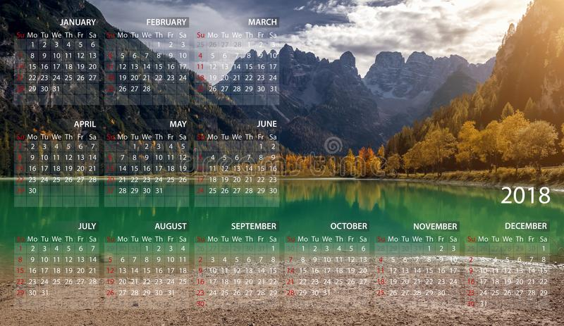 Calendar 2018 in English. Week starts on sunday. Mountains panorama landscape in Italy royalty free stock images