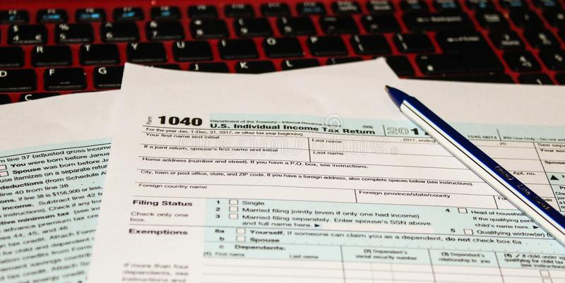 Calendar And Form 1040 Income Tax Form For 2017 Showing Tax Day For