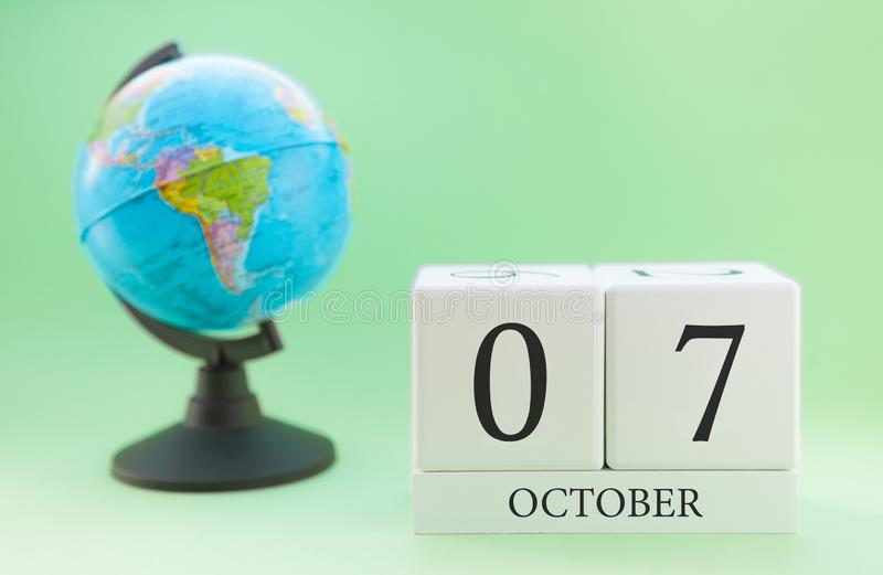 Calendar made of wood on a light green background, 07 day of the month October, autumn 7th day royalty free stock photography