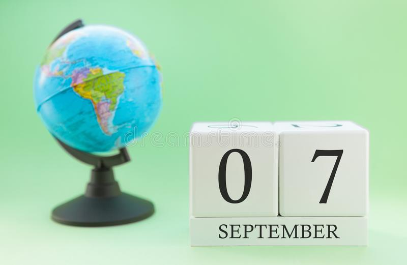 Calendar made of wood on a light green background, 07 day of the month September, autumn 7th day stock photography